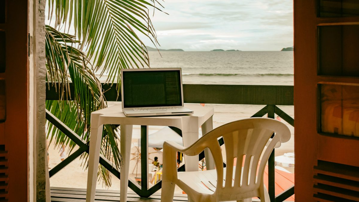 Image of computer in tropical area for article on Legal-Hold-and-Document-Rentention-Practices-for-Remote-Work-WFH-Distributed-Workforce